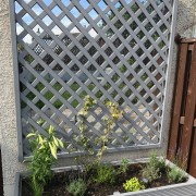 Raised herb beds with mirror trellis panels alongside patio Added by Belinda Macdonald, Shades of Green
