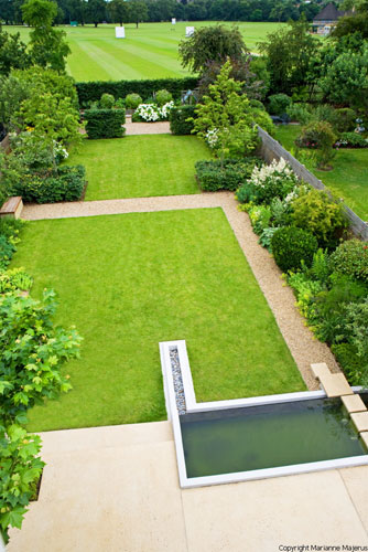 Large family garden with infinity edge pool shoot for Large garden pool