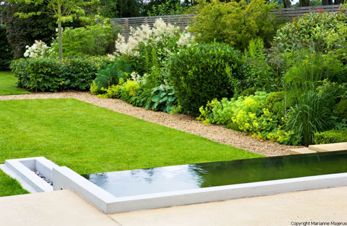 Large family garden with infinity edge pool shoot for Garden landscaping ideas for large gardens