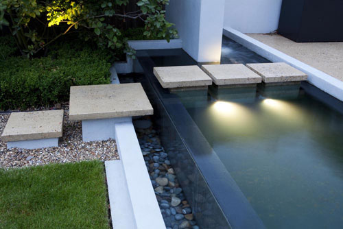 Large family garden with infinity edge pool shoot for Square pond ideas