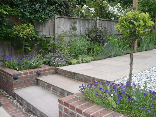 Sloping, long thin garden by garden designer Andrea Newill MSGD