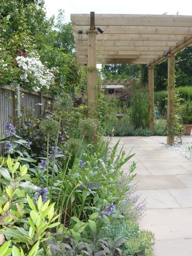Sloping long garden by garden designer Andrea Newill