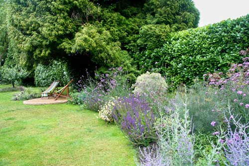 Town garden with raised pool, Haslemere, Surrey by Hampshire garden designer Janet Bligh