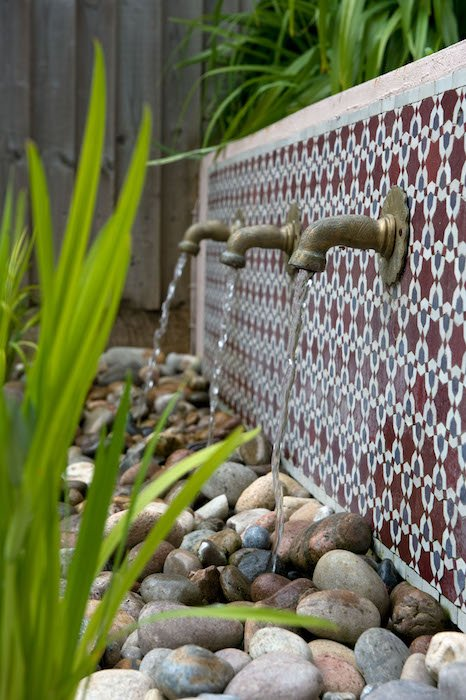 A tap water feature creates sound in the garden